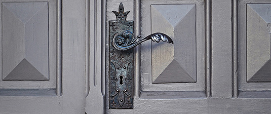 closed doors and wrought iron handle