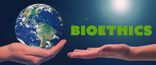 hand holding the earth in its palm with text bioethics