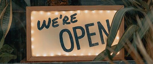 open sign in store window